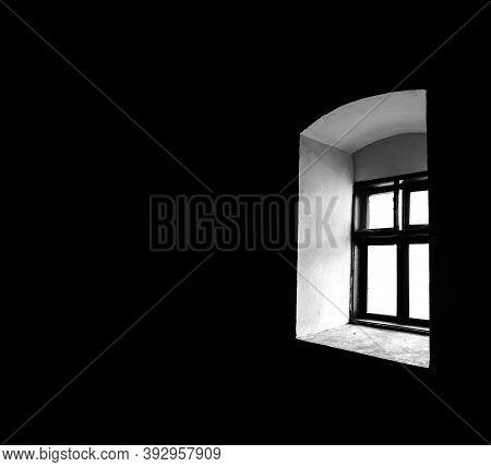 Window In A Dark Room. Small Old Window In A Black Room.