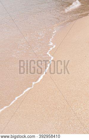 Soft Beautiful Sea Wave On Sandy Beach. Background Texture. Wet Sandy Beach