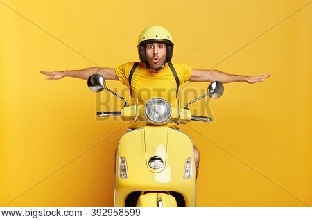 Shocked Male Motorcyclist Travels On Motorbike, Has Adventure Trip And Feels Extreme, Keeps Hands Aw