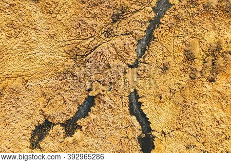 Aerial View Of Dry Grass And Frozen Marsh Swamp Landscape In Late Autumn Day. High Attitude View. Ma