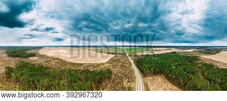 Aerial View Of Highway Road Through Deforestation Area Landscape. Green Pine Forest In Deforestation