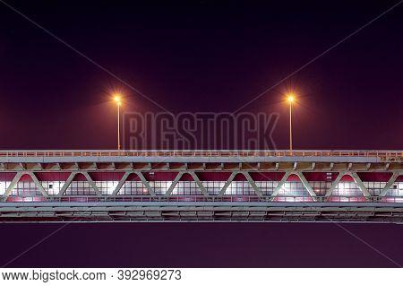 Night Rapid Transit Bridge Lighting. Minimalistic Light, Copy Space. Two Lamppost With Yellow Lighte