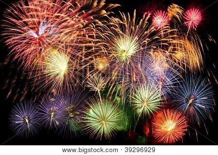 Fireworks display in grand finale over dark background poster