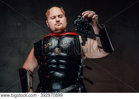 Great And Status Roman General In Black Armour With Red Cape And Wreath On His Bald Head Holds Grape