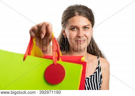 Close-up Of Adult Woman Wearing Casual Summer Attire Offering Presenting Gift Or Shopping Bags To Ca