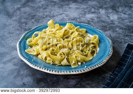 Pappardelle Pasta With Grated Parmesan Cheese Par In Plate Ready To Serve And Eat.