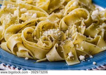 Pappardelle Pasta With Grated Parmesan Cheese Par In Plate Ready To Serve And Eat / Macro Close Up V