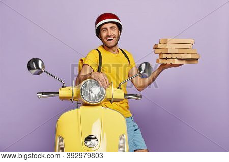 Happy Male Involved In Customer Service, Picks Up Pizza, Wears Helmet, Yellow T Shirt, Carries Rucks