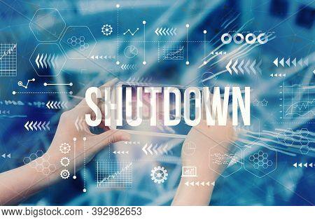 Shutdown Coronavirus Theme With Person Using A Smartphone