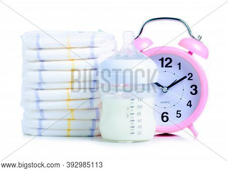 Baby Diapers With Baby Bottle Milk, Clock Alarm On White Background Isolation, Time For Eating Conce