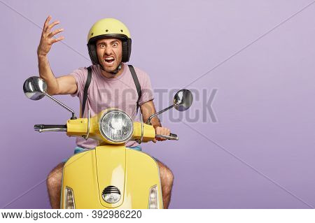Irritated Impatient Guy Works In Delivery Service, Annoyed With Traffic Jam On Road, Raises Hand In
