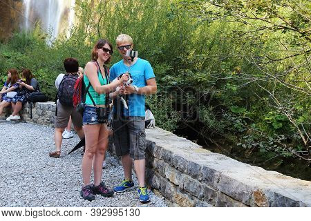Plitvice, Croatia - September 13, 2016: An Unidentified Happy Young Couple Takes A Selfie With Their