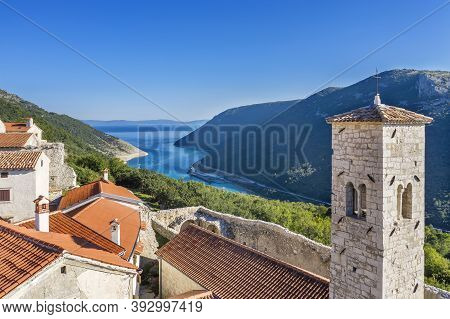 An Aerial View Of Plomin Channel And Bell Tower, In Background Plomin Channel, Istria, Croatia