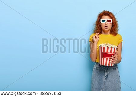 Frightened Young Woman With Foxy Hair, Visits Cinema Session, Watches Scarying Movie In 3d Glasses,