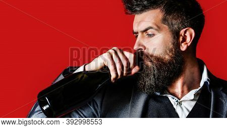 Man Holding Bottle With Champagne, Wine. Bearded Man With A Bottle Champagne Of And Glass. The Perso