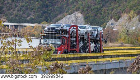 Cars Carrier At The Road Of Romania- Cross A Bridge. Truck Transporte. Romania, Severin. November, 0