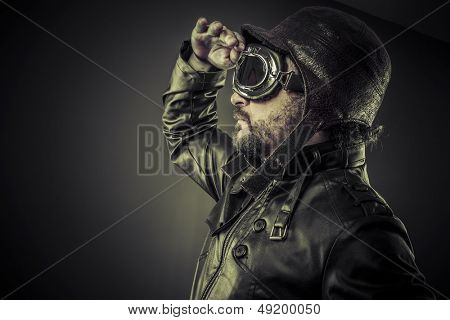 Steampunk concept, pilot vintage with big glasses, posing poster