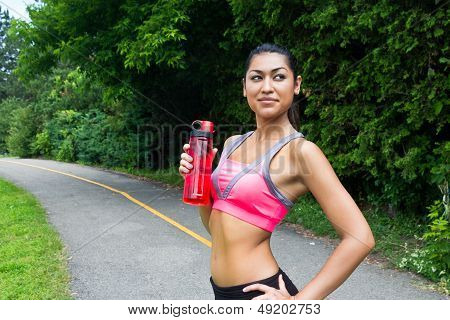 Fit Young Woman With Water Bottle After Running