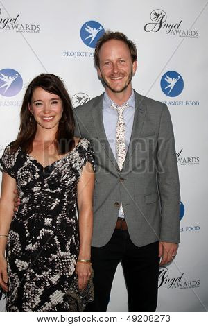 LOS ANGELES - AUG 10:  Marguerite Moreau, Christopher Redman at the Angel Awards at the Project Angel Food on August 10, 2013 in Los Angeles, CA