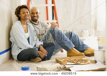 Couple taking lunch break from painting