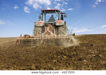 Red Tractor Working