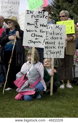Children Holding Signs At Tea Party.