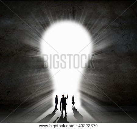 Silhouette of businesspeople against black wall. Idea concept poster