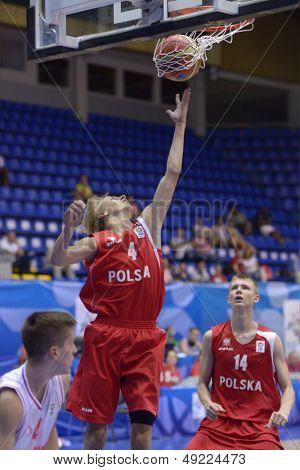 KIEV, UKRAINE - AUGUST 8: Szymon Walczak (center) and Michal Kolenda of Poland during the U16 Eurobasket 2013 Qualifier match Poland vs Montenegro at Palace of Sport in Kiev, Ukraine on August 8, 2013