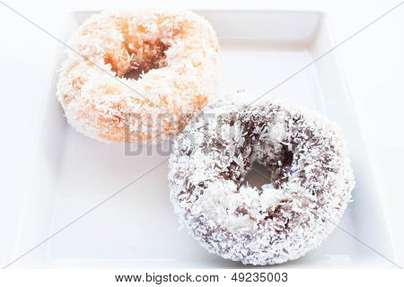 Chocolate And Vanilla Donuts With Coconut Cover