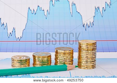 Uptrend Golden Coin Stacks, Green Pencil And Financial Chart As Background. Selective Focus