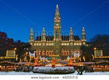 Festively illuminated Christmas fair and city hall in Vienna, Austria. poster