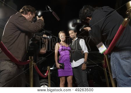 Celebrity couple being photographed at media event