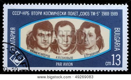 BULGARIA- CIRCA 1989: A stamp printed in Bulgaria shows Cosmonauts Anatoly Solovyev, Viktor Savinykh, Aleksandr Panayatov Aleksandrov of space ship Soyuz TM-5, circa 1989