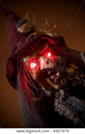 Witch Puppet With Red Glowing Eyes