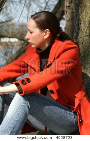 Sad Woman Sitting Outdoor