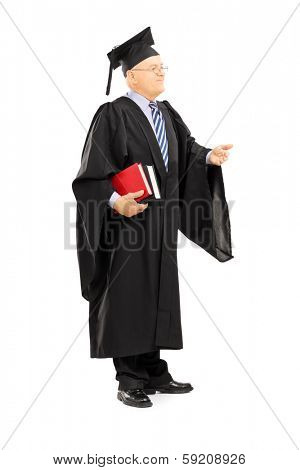 Full length portrait of a college professor in graduation gown holding books isolated on white background
