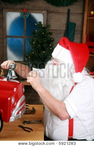 Santa in his workshop in the north pole