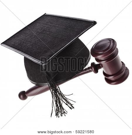 A mortarboard and gavel are isolated for law graduates.   Isolated on White Background