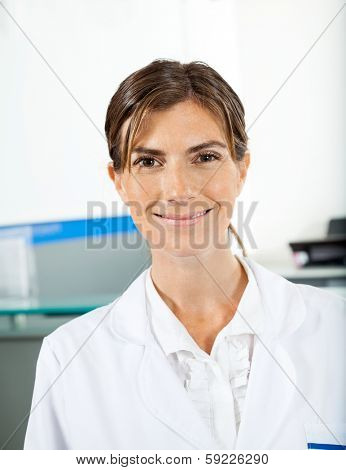 Portrait of smiling female researcher in hospital