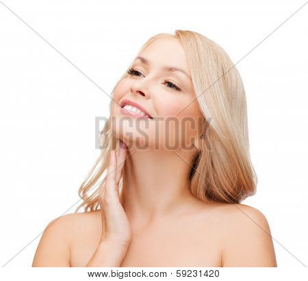 heath and beauty concept - face of beautiful woman touching her neck
