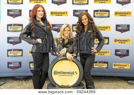 Daytona Beach, FL - Jan 24, 2014:  The Continental Tire models pose for a photo at the Continental Tire display in the infield of the Daytona International Speedway in Daytona Beach, FL.