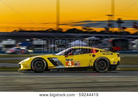 Daytona Beach, FL - Jan 25, 2014:  The Corvette Racing Chevrolet travels through the turns during Rolex 24 at Daytona at Daytona International Speedway in Daytona Beach, FL.