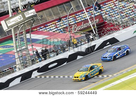 Daytona Beach, FL - Jan 24, 2014:  Bill Auberlen and Paul Dalla Lana win the BMW Performance 200 at Daytona International Speedway in Daytona Beach, FL.