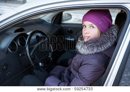 Woman In Winter Clothes Sitting In His Car