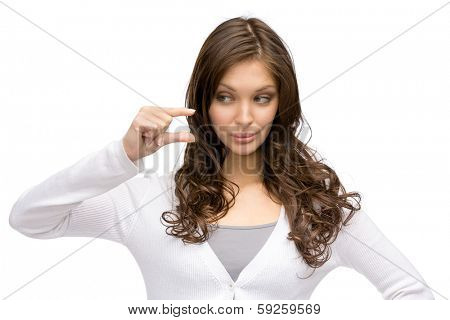 Portrait of girl showing small amount of something, isolated on white