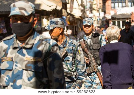 KATHMANDU, NEPAL - NOV 29: Soldiers during protest within a campaign to end violence against women (VAW), Nov 29, 2013 in Kathmandu, Nepal. Held annually since 1991, 16 days Nov 25 - Dec 10.
