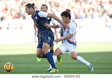 CARSON, CA. - FEB 01: USA D Omar Gonzalez #4 & Korea M Min-Woo Kim #15 during the U.S. mens national team soccer friendly against Korea Republic on Feb 1st 2014 at the StubHub Center in Carson, Ca.
