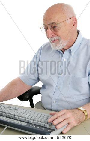 Senior Man Enjoys Computer