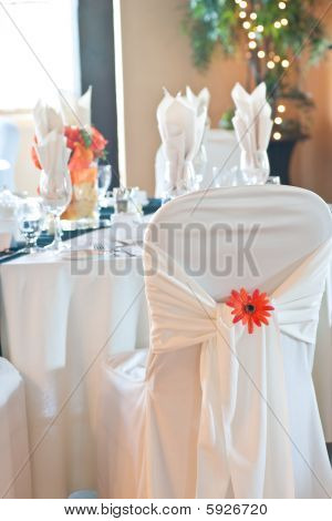 Chair Covering And Table Setting At Wedding