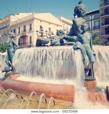 Turia Fountain in the Plaza de la Virgen Valencia Spain with retro effect